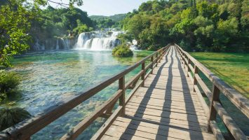 A wooden bridge is the center of the NP Krka and most attractive place