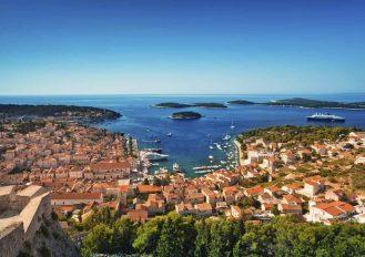 Harbor of old Adriatic island town Hvar. High angle panoramic view. Popular touristic destination of Croatia.